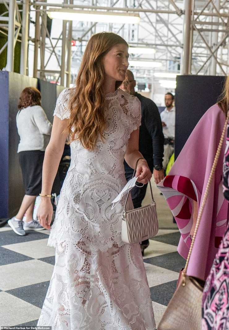 Jennifer, 25, held a matching white purse to go with her all white, lace dress