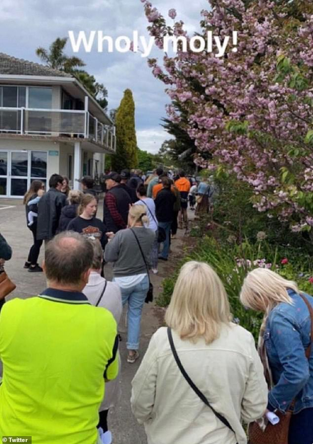 About one hundred people were seen gathering outside a doctor's office in the Colac suburb of Elliminyt, about 150km southwest of Melbourne on Wednesday (pictured)