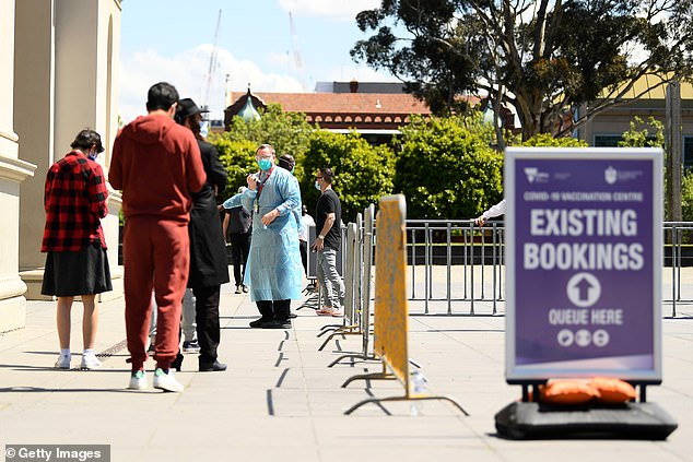 Healthcare workers are seen at a vaccination centre in Melbourne this week