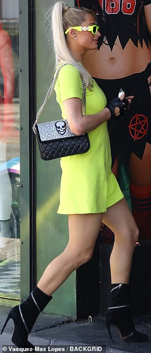 Here and there: The duo appeared to be getting ready for their Halloween festivities as Paris, 40, was seen sauntering into a costume store