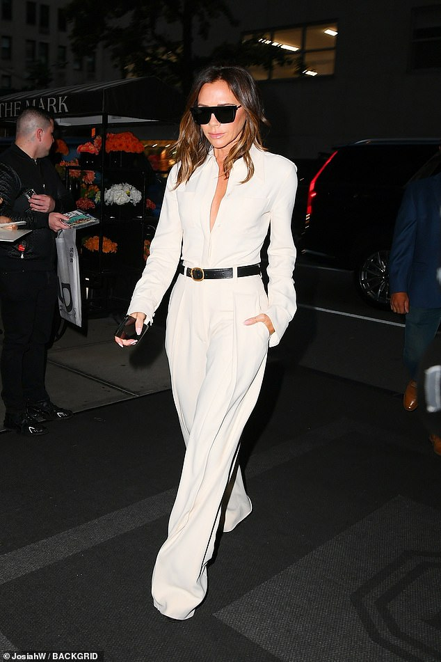 Sharp:The 47-year-old strolled towards her hotel in a stylish white wide-legged jumpsuit that she left partially unbuttoned to show off her décolletage