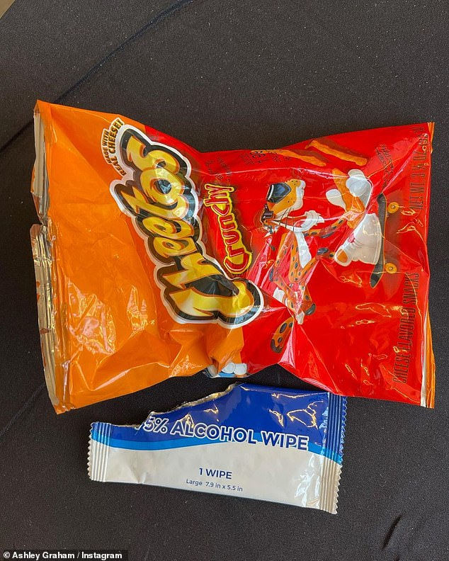 Cheetos: The model also shared a snap of an empty bag of Cheetos and alcohol wipes before returning to the model photos