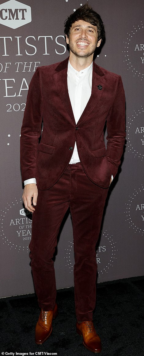 Swanking about: Morgan Evans who is one of the presenters was more formal in a red velour suit