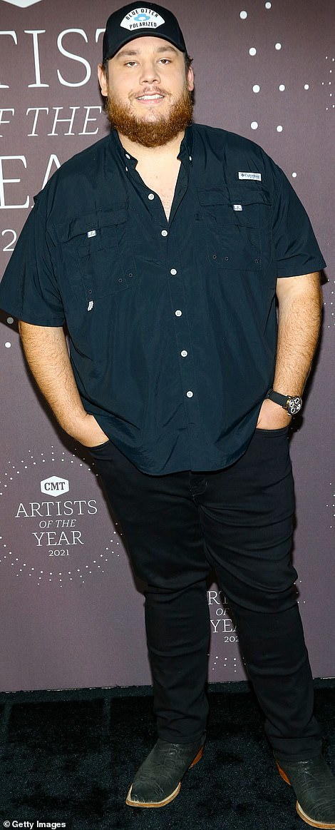 Gent:Luke Combs who is one of the evening's honorees cut a casual figure in a short-sleeved shirt and baseball cap