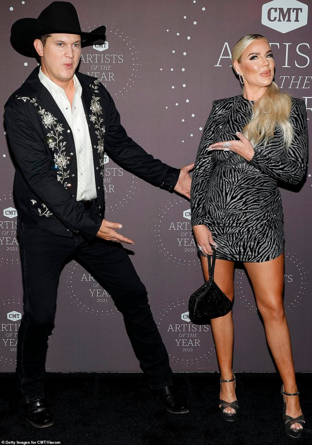 Such fun:Jon Pardi meanwhile was ever the showman as he struck a flashy pose on the red carpet, gesturing toward his wife Summer, with whom he will celebrate his first wedding anniversary next month