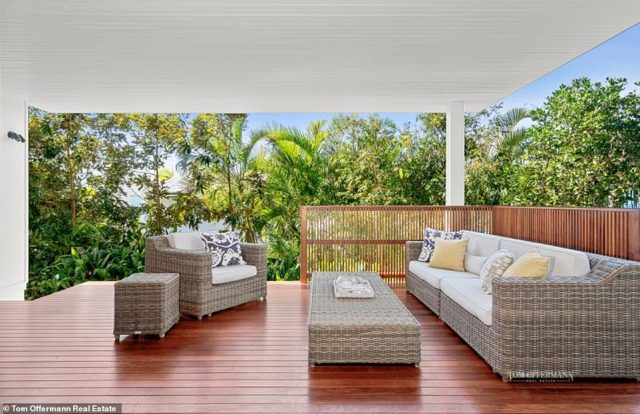 The outdoor deck areas with wooden flooring would be ideal for entertaining guests