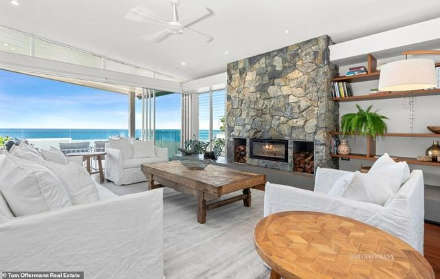The open plan living offers a luxurious design with beachside facing kitchen, multiple dining spaces and sophisticated lounge with centrepiece stonemasonry wood-burning fireplace