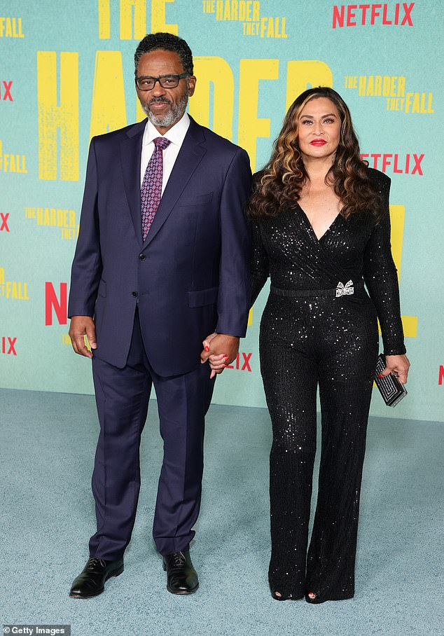 Standing by her man:Tina's 74-year-old husband looked dapper in a blue suit with white dress shirt, patterned tie and black leather dress shoes