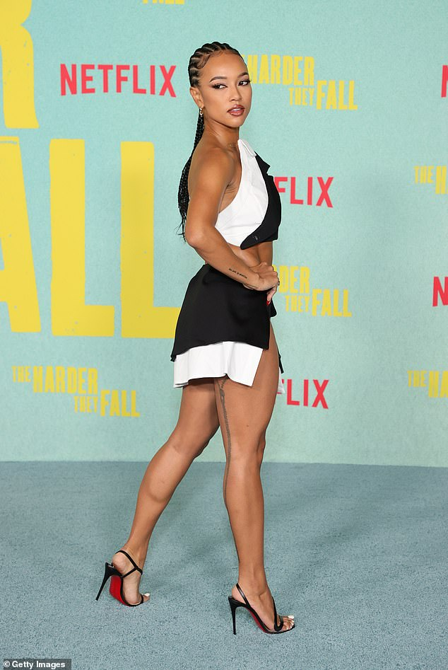 Knows what she is doing:She teamed the look with a pair of strappy stilettos as she put on a pose exhibition on the green carpet