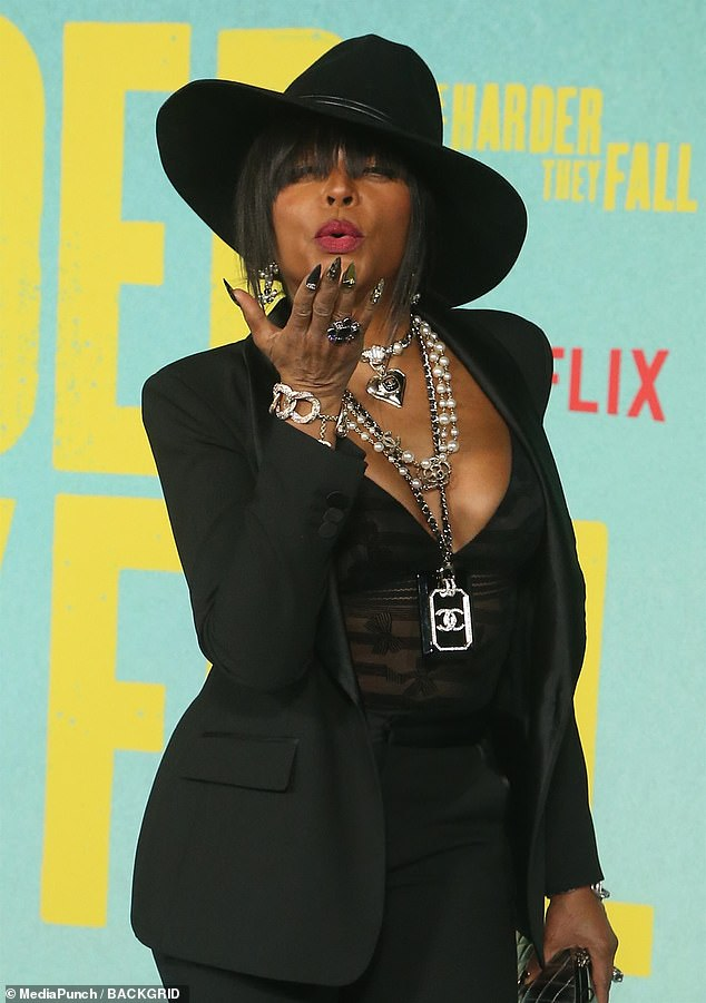 Pucker up: Taraji rocked plenty of jewelry including many beaded Chanel necklaces along with diamond encrusted bracelets