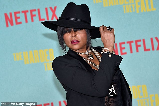Proud:The former star of Empire accessorized the look with a shimmering silver Chanel clutch bag and a large black fedora