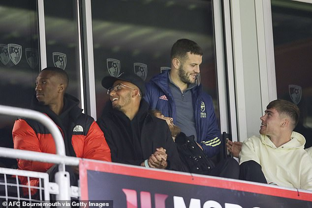 Wilshere (second from right) watched Arsenal and Bournemouth's U23 sides face off earlier this month