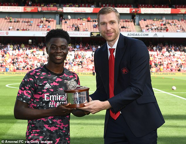 However, Mertesacker (right) believes Saka (left) and Smith Rowe can inspire generations