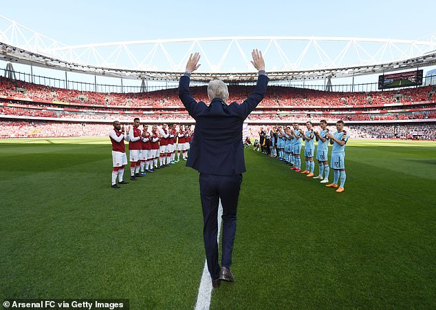 Wenger admits that finally leaving Arsenal felt 'like a funeral' following two decades at the club - here he waves goodbye to their fans at the Emirates Stadium in 2018