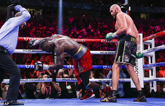 Tyson Fury retained his WBC belt with an empathic stoppage win over Deontay Wilder