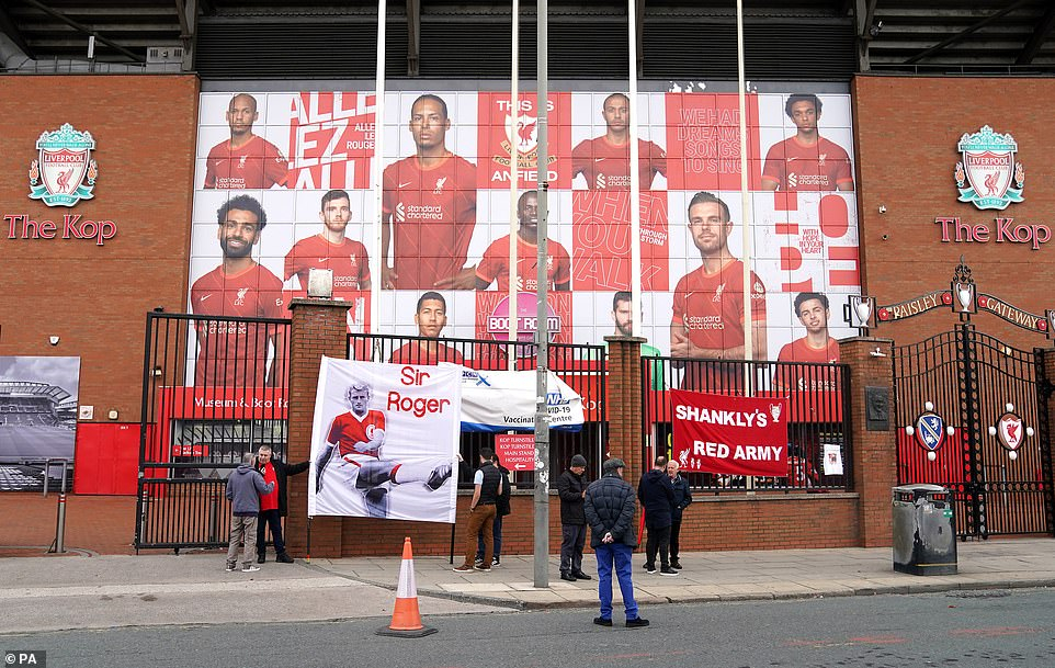Liverpool fans placed banners on the fence in front of The Kop at Anfield as they prepared for Hunt'shearse to stop there