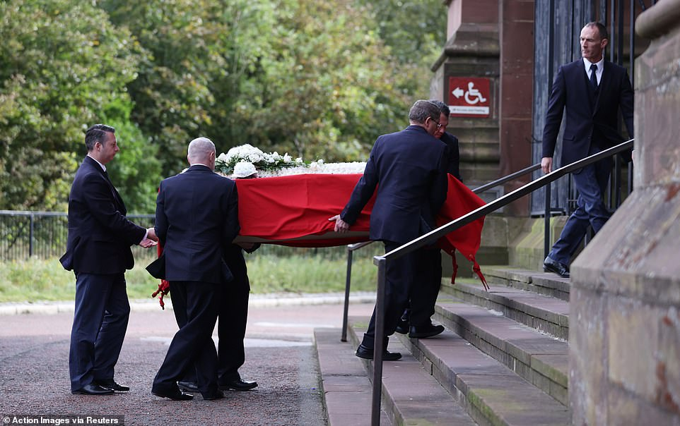 Pallbearers carry the coffin of Hunt inside before the service as they arrive for the funeral ceremony at Liverpool Cathedral