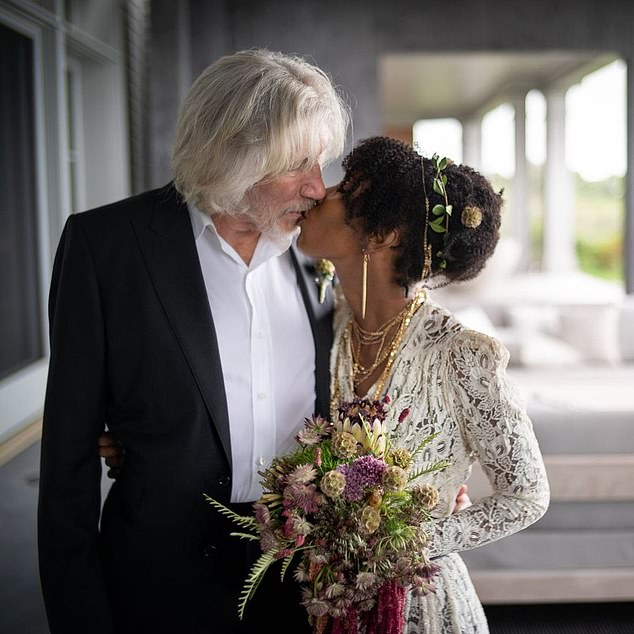 So in love: Kamilla looked gorgeous in a white lace wedding dress and the couple looked very in love