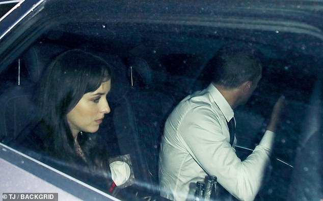 Heading home: Dakota looked rather glum after the night was over