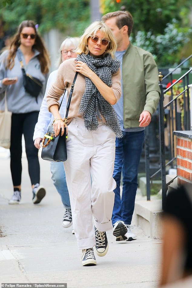 , Sienna Miller looks relaxed in a taupe jumper and mom jeans, The Habari News New York