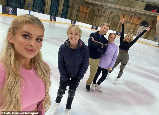 Exciting: In a second snap shared by Sally, she, Kimberly and Liberty posed alongside skating legends Jayne Torvill and Christopher Dean