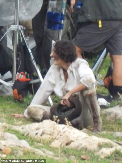 Action girl!  Her ensemble was covered in dirt as she struggled on the floor with Hollywood legend Harrison