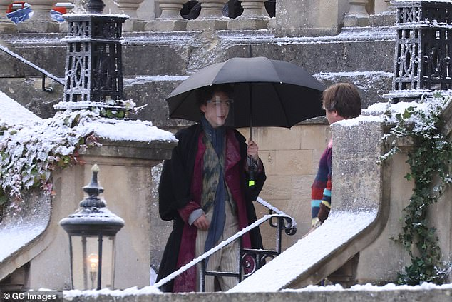 Rain: The actor appeared to be wet and also donned an extra brown coat over his costume