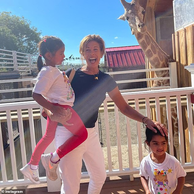 Candid:Hoda Kotb, 57, opened up about telling her daughters Haley, four, and Hope, two, they're adopted during her appearance on People's new podcast 'Me Becoming Mom'