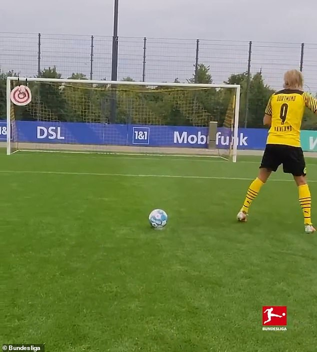 Borussia Dortmund striker Haaland stacked three balls on top of each other and struck a target