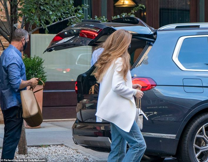 A porter was seen helping load Jennifer's baggage onto the back of a black SUV after she checked out of the ritzy hotel