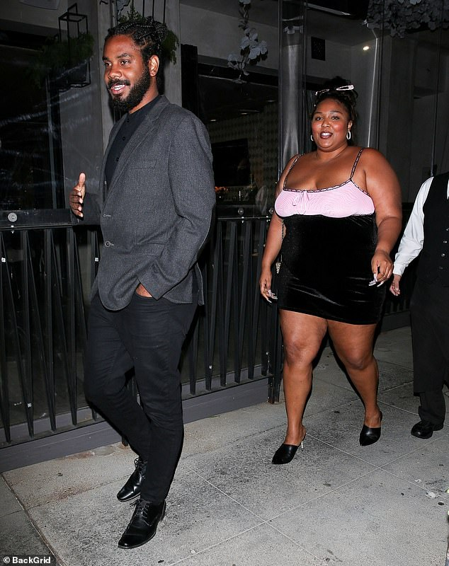 Out on the town: Lizzo, 33, beamed ear-to-ear as she stepped out with a mystery man she's previously been with during a dinner date at Crustacean in Beverly Hills on Wednesday