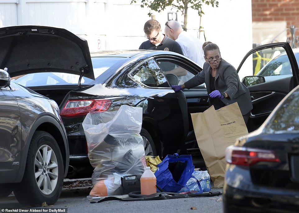 Detectives collecting evidence, including from Officer Yvonne Wu's car on Thursday. She is yet to be charged