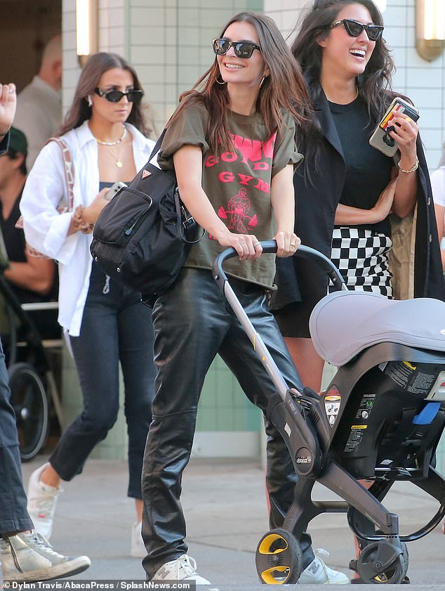 Out and about:Emily Ratajkowski stepped out for lunch with her son Sylvester in New York on Thursday afternoon