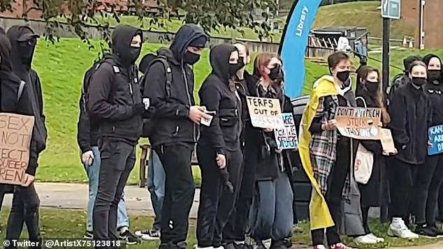 A group of masked demonstrators at the University of Sussex staged a protest on campus demanding lecturer Kathleen Stock lose her job