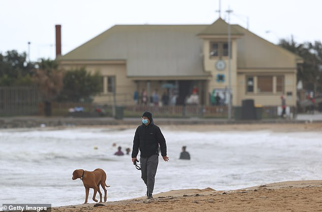 Melburnians will be travel beyond 15km of their homes for the first time in 78 days on Friday (pictured resident walking his dog at Williamstown Beach on Saturday)