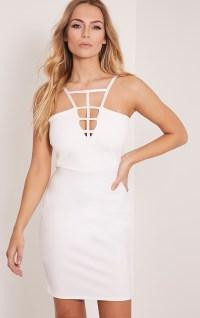 Miranda Kerr dons white gown as she attends pre-Grammy ...