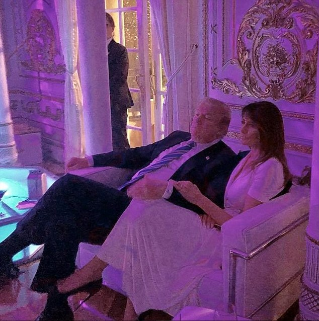 Donald Trump and wife Melania were pictured getting cozy at an event at Mar-a-Lago Saturday night despite rumors of a rift