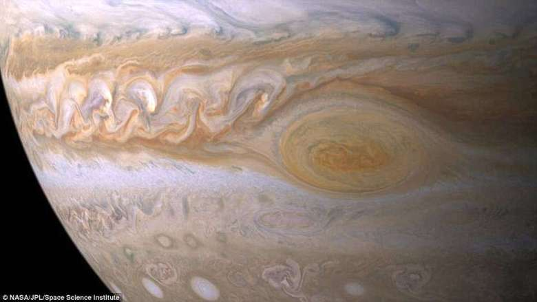 Trapped between two jet streams, the Great Red Spot is an anticyclone swirling around a centre of high atmospheric pressure that makes it rotate in the opposite sense of hurricanes on Earth. Nasa's Juno spacecraft passed about 5,600 miles (9,000 kilometers) above the Giant Red Spot clouds in July of 2017