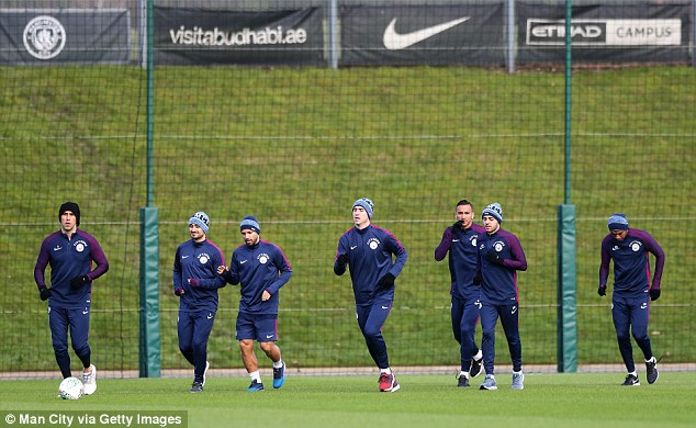 Aguero (third from left) runs alongside Ilkay Gundogan and his Manchester City team-mates