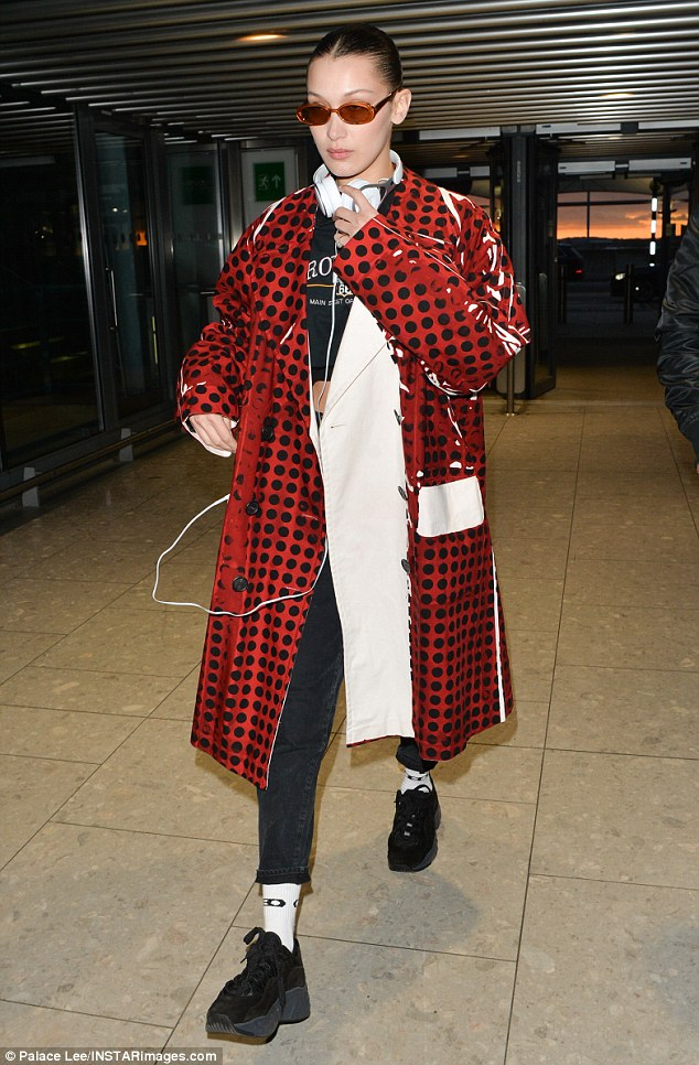 Hard to miss:Bella Hadid commanded attention as she prepared to depart the United Kingdom via Heathrow Airport on Tuesday afternoon