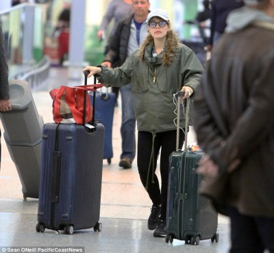 Hiding a bump? The last time Rachel was photographed was at an airport in Toronto in baggy clothes in late November