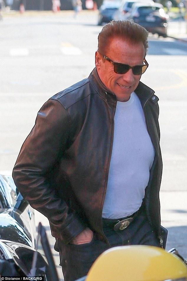 Arnold And Patrick Schwarzenegger Wear Warm Coats In LA