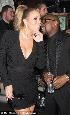 Care to share? The retired boxer appeared to murmur something funny into Mariah's ear