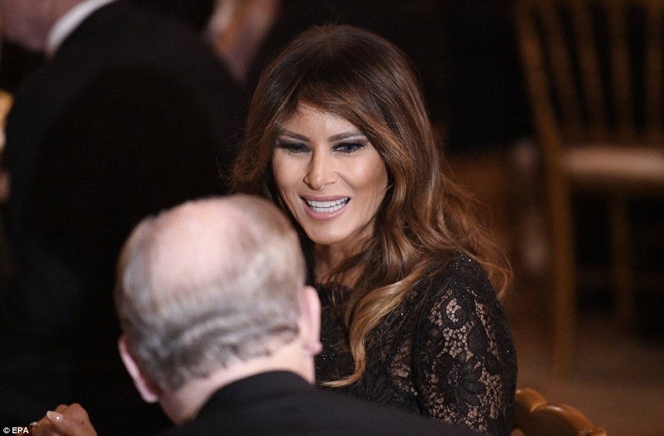 Melania looks charmed as she beams from ear to ear during a conversation with one of the attendees at the 2018 Governors' Ball
