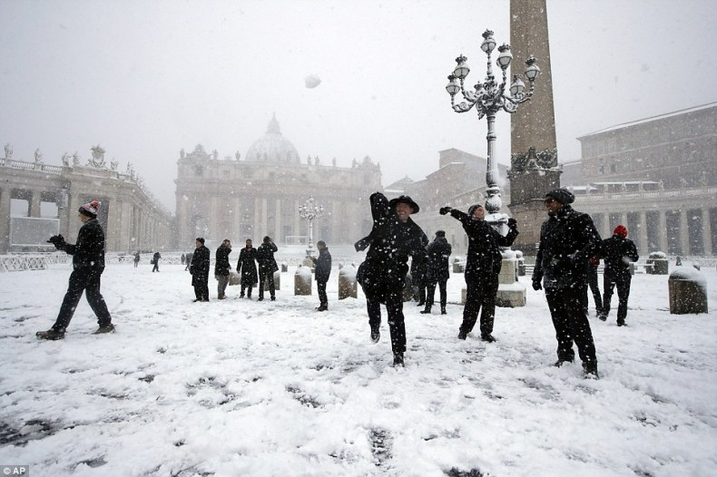 Shawn Roser, from Venice, Florida, a student at the North American college in Rome, throws a snowball in St. Peter's Square at the Vatican on Monday