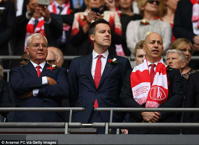 Josh Kroenke (centre) is the son of owner Stan but spends most of his time in America