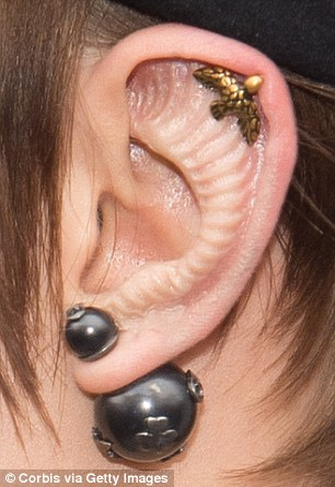 She sported what appeared to be an other-worldly prosthetic stuck into her ear