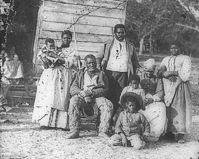 A family on Smith's Plantation in Beaufort, South Carolina, back in 1862. Mothers, like the one pictured left,  who gave birth to children on the plantations, were expected to return to work as soon as possible and child slaves were sometimes separated from their families. Limited, cramped conditions and the lack of state recognition of slave marriage often led to children being placed with adults other than their parents or being sent to sleep on a mat in the master's house