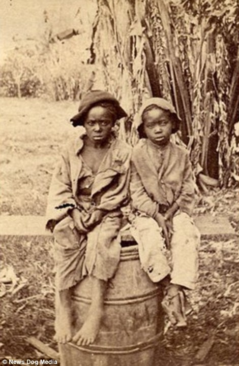 An undated rare photograph of what is thought to be two slave children who had been emancipated, circa 1870