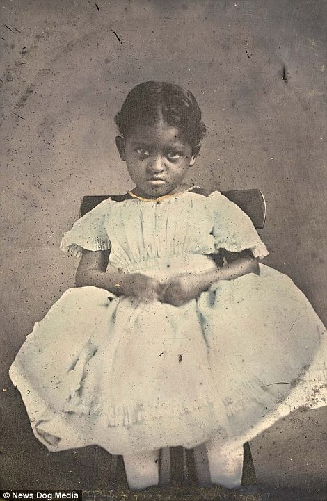 Another African-American child sits on a chair with an unimpressed expression on her face. It is not known whether or not the girl is a slave, but it is thought the picture was taken in Alabama around 1856